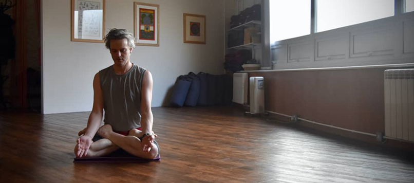 James Russell in lotus posture at Yoga Torquay