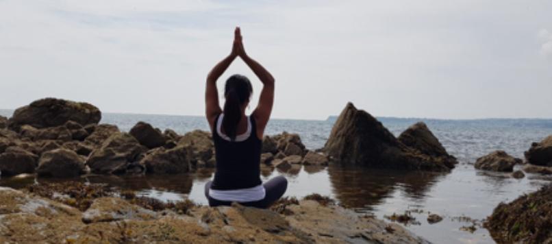 Jessica Akiki practising yoga in Torbay